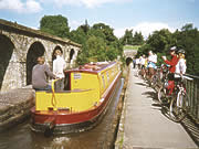 Cyclists and barges on Chirk Aquaduct